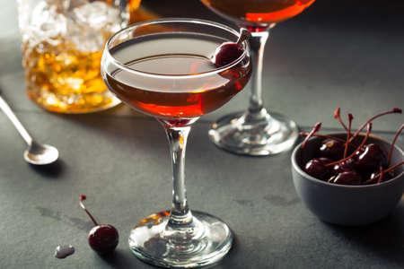 sweet vermouth: Homemade Rye Bourbon Manhattan with a Cherry Garnish Stock Photo