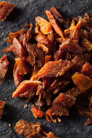 smoked: Dried Smoked Salmon Jerky with Salt and Pepper Stock Photo