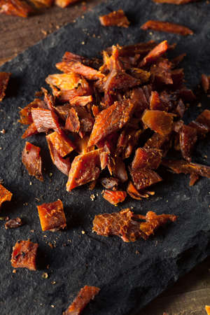 dried fish: Dried Smoked Salmon Jerky with Salt and Pepper Stock Photo