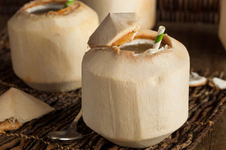 coconut drink: Raw White Young Coconut Drink with a Straw