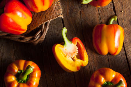 red bell pepper: Raw Organic Striped Red Bell Pepper Ready to Cook With Stock Photo