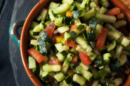 gallo: Raw Homemade Cucumber Pico De Gallo Salsa with Chips Stock Photo