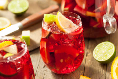 citrus: Homemade Fruity Spanish Red Sangria with Apples and Citrus Stock Photo