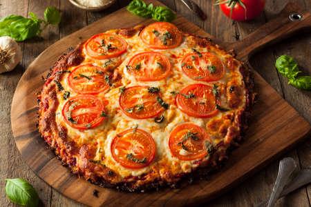 Homemade Vegan Cauliflower Crust Pizza with Tomato and Basil