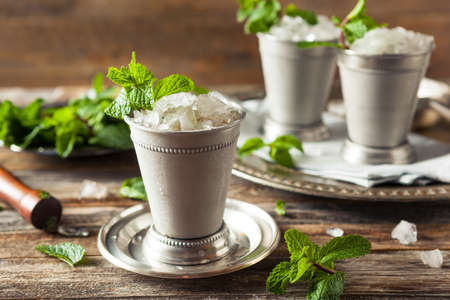 bourbon: Cold Refreshing Classic Mint Julep with Mint and Bourbon Stock Photo