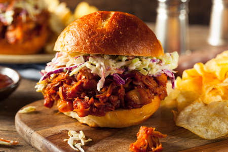 Homemade Vegan Pulled Jackfruit BBQ Sandwich with Coleslaw and Chips Stock Photo