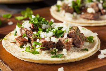 cilantro: Homemade Carne Asada Street Tacos with Cheese Cilantro and Onion