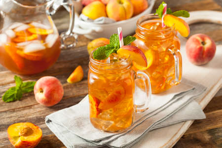 Fresh Homemade Peach Sweet Tea with Mint Stock Photo