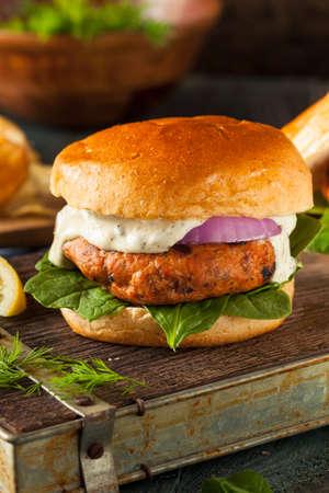 Salmon: Homemade Salmon Burger with Tartar Sauce and Onion Stock Photo