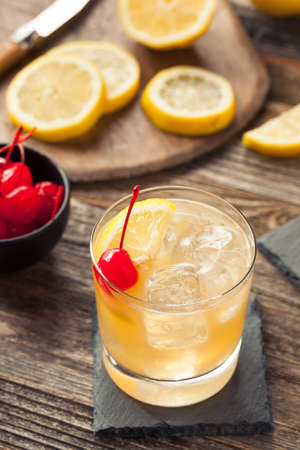 sour cherry: Homemade Whiskey Sour Cocktail Drink with a Cherry Lemon