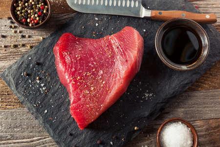 Raw Organic Pink Tuna Steak with Salt and Pepper