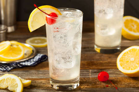 collins: Refreshing Classic Tom Collins Cocktail with a Cherry and Lemon Slice Stock Photo