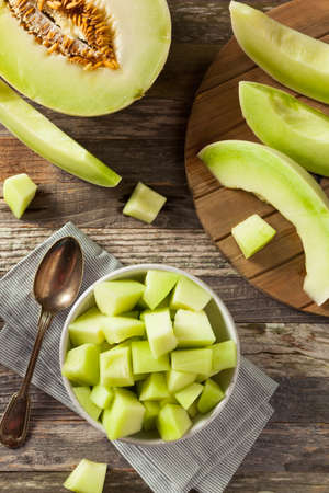 honeydew: Green Organic Honeydew Melon Cut in a Bowl