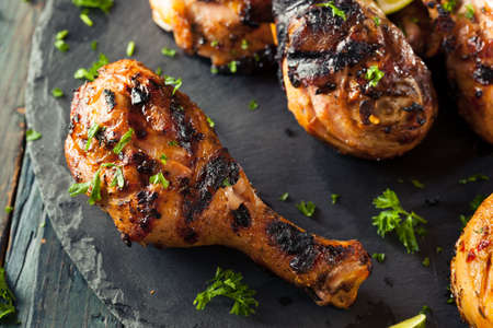 jamaican food: Spicy Grilled Jerk Chicken with Lime and Spices