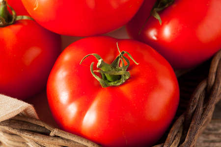 beefsteak: Raw Organic Red Beefsteak Tomatoes Ready for Cooking Stock Photo