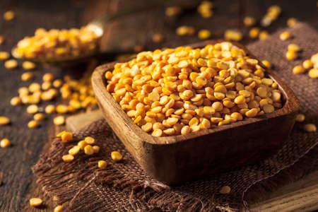 pea: Raw Organic Yellow Split Peas in a Bowl Stock Photo