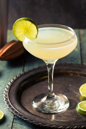 bartending: Classic Lime Daiquiri Cocktail with a Garnish Stock Photo