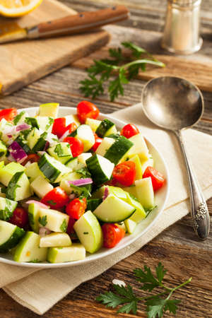 cucumber salad: Healthy Organic Cucumber Salad with Parsley and Tomatoes Stock Photo