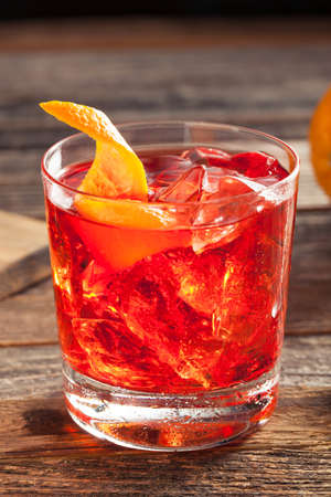sweet vermouth: Homemade Boozy Negroni Cocktail with and Orange Twist Stock Photo