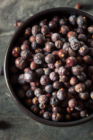 juniper: Raw Organic Juniper Berries in a Bowl