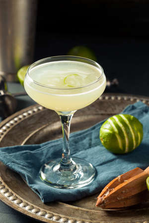 daiquiri alcohol: Alcoholic Lime and Gin Gimlet with a Garnish Stock Photo