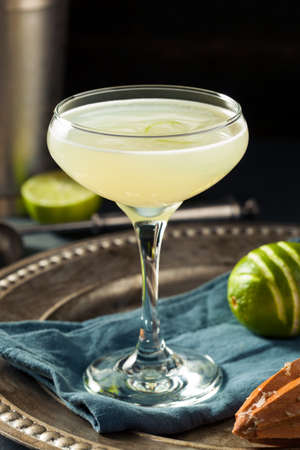 gimlet: Alcoholic Lime and Gin Gimlet with a Garnish Stock Photo