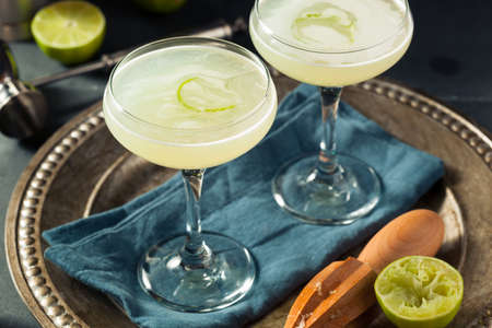 Alcoholic Lime and Gin Gimlet with a Garnish Stok Fotoğraf