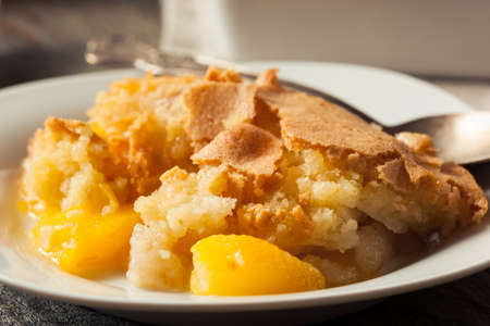 satisfying: Delicious Homemade Peach Cobbler with a Pastry Crust