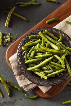 dehydrated: Healthy Nutritious Dehydrated Green Bean Chips for a Snack Stock Photo
