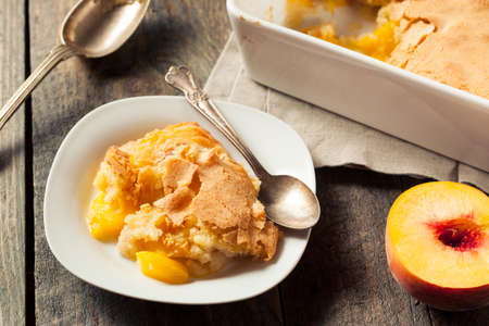 Delicious Homemade Peach Cobbler with a Pastry Crust Stock Photo - 60764544