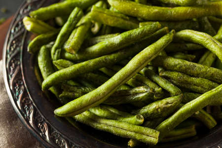 green bean: Healthy Nutritious Dehydrated Green Bean Chips for a Snack Stock Photo