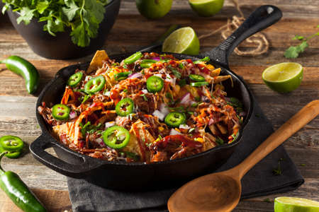 Homemade Barbecue Pulled Pork Nachos with Cheese and Peppers