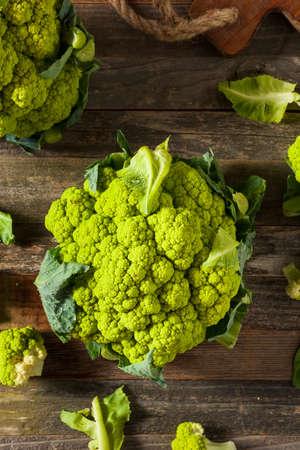 head of cauliflower: Raw Organic Green Broccoli Cauliflower Ready for Cooking