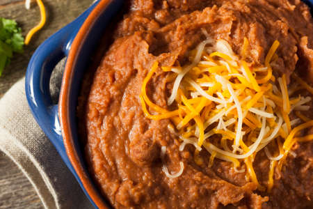 pinto beans: Homemade Refried Pinto Beans with Chiips and Lime Stock Photo