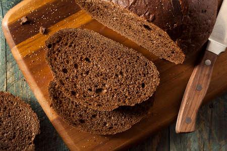 pumpernickel: Homemade Organic Pumpernickel Rye Bread Cut into Slices