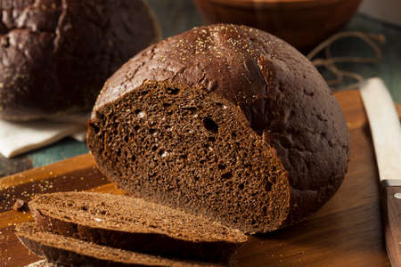 Homemade Organic Pumpernickel Rye Bread Cut into Slices