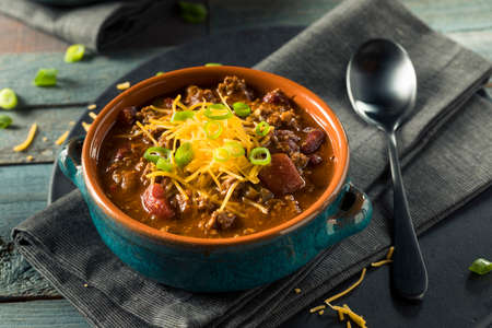 red onions: Homemade Beef Chili Con Carne with Cheese and Onions Stock Photo