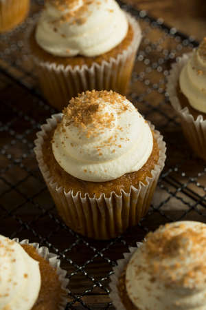 frosting': Sweet Homemade Pumpkin Spice Cupcakes with Frosting Stock Photo