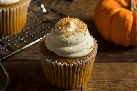 Sweet Homemade Pumpkin Spice Cupcakes with Frosting Stock Photo