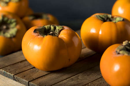 Raw Organic Yellow Persimmons Ready for Cooking Stock Photo