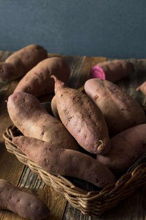 potato plant: Raw Organic Purple Sweet Potatoes Stock Photo