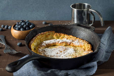 dutch: Homemade Dutch Baby Pancake with Blueberries and Powdered Sugar