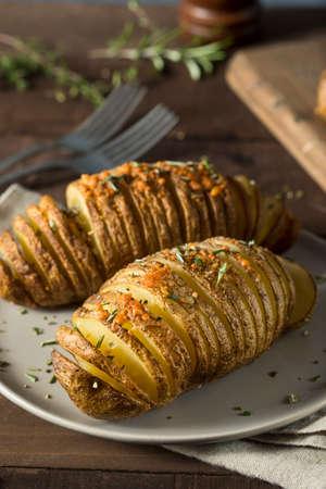 Homemade Cheesy Hasselback Potato with Fresh Herbs