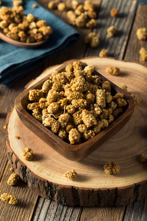 superfruit: Raw White Dried Mulberries in a Bowl Stock Photo