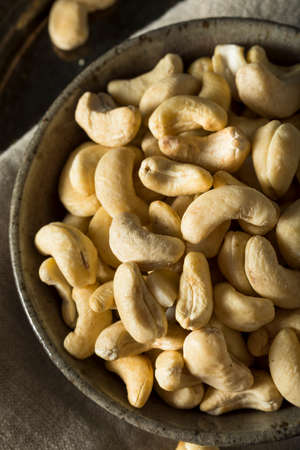 Raw Organic White Chashew Nuts in a Bowl Stock Photo
