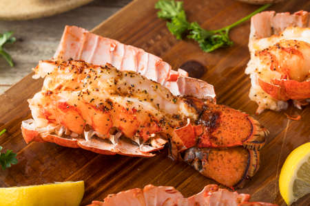Seasoned Baked Lobster Tails with Lemon and Butter Sauce Stock Photo - 68148775
