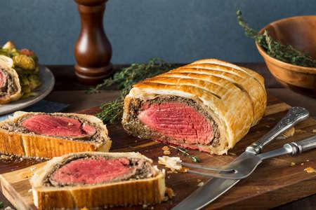 Homemade Christmas Beef Wellington with a Pastry Crust Фото со стока