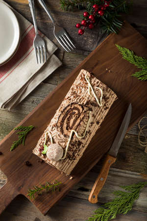yule log: Homemade Chocolate Christmas Yule Log with Mousse and Frosting Stock Photo