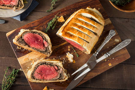 Homemade Christmas Beef Wellington with a Pastry Crust Foto de archivo