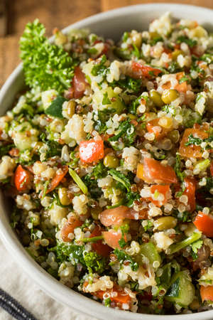 red quinoa: Healthy Organic Quinoa Tabouli Salad with Tomato and Cucumber Stock Photo